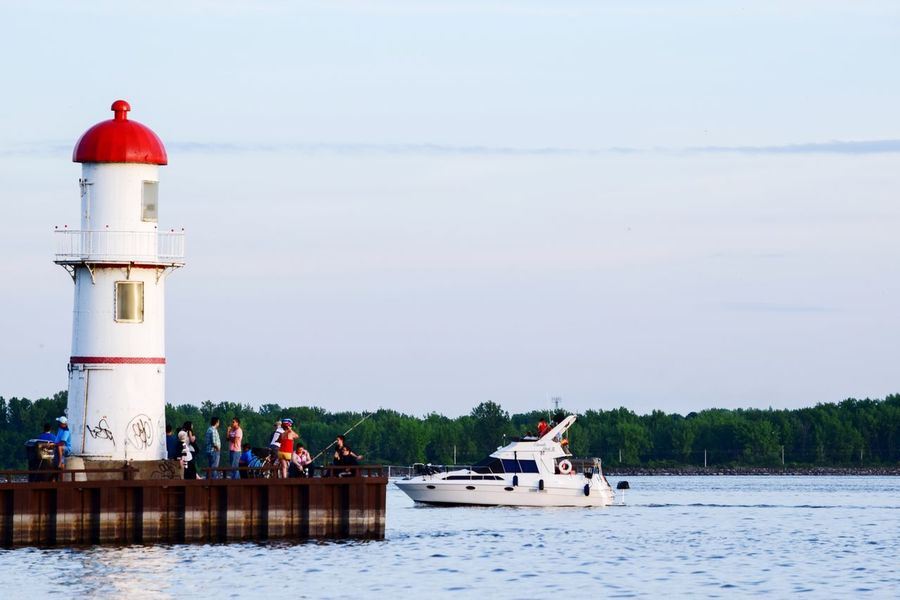 Water Lighthouse Nautical Vessel Day Transportation Outdoors Nature Harbor Horizon Over Water Summer Dock Pier Group Of People Fishing Boat Navigation Scenics Sky EyeEmNewHere Canada Montréal Lachine