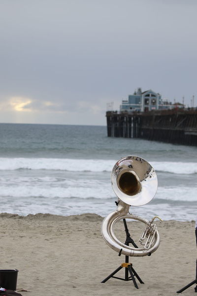 Beach Cloud - Sky Day Horizon Over Water Music Instrument Nature No People Ocean Outdoors Pier Sand Scenics Sea Sky Tuba Water