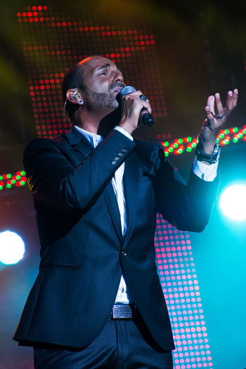 Singer Performing In Concert