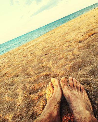 закат пляж море beach sea sand horizon over water barefoot #закат #пляж #море Beach Sea Sand Horizon Over Water Shore Water Day Real People Sky Nature One Person First Eyeem Photo