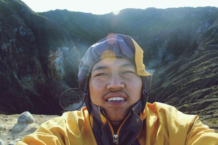 Portrait of man against mountain