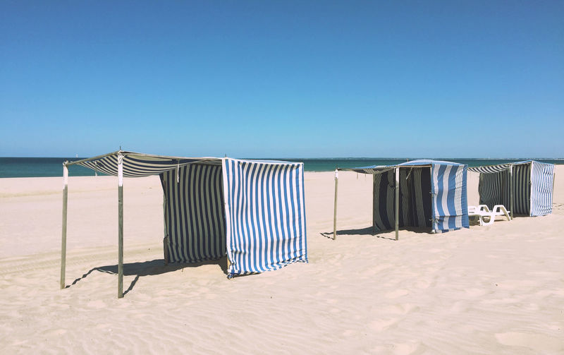 Absence Beach Beach Tent Blue Blue Sky Horizon Over Water Outdoors Pastel Power Relaxation Sand Sea Shore Summer Vacations Everything In Its Place Stripes Pattern Blue And White Landscapes With WhiteWall The Essence Of Summer- 2016 EyeEm Awards Holiday Fine Art Photography