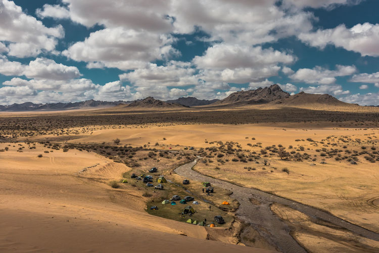 Mongolia Cloud - Sky Sky Environment Scenics - Nature Landscape Beauty In Nature Land Desert Tranquil Scene Mountain Nature Non-urban Scene Tranquility Day Climate Sand Arid Climate Mode Of Transportation Transportation Land Vehicle No People Outdoors