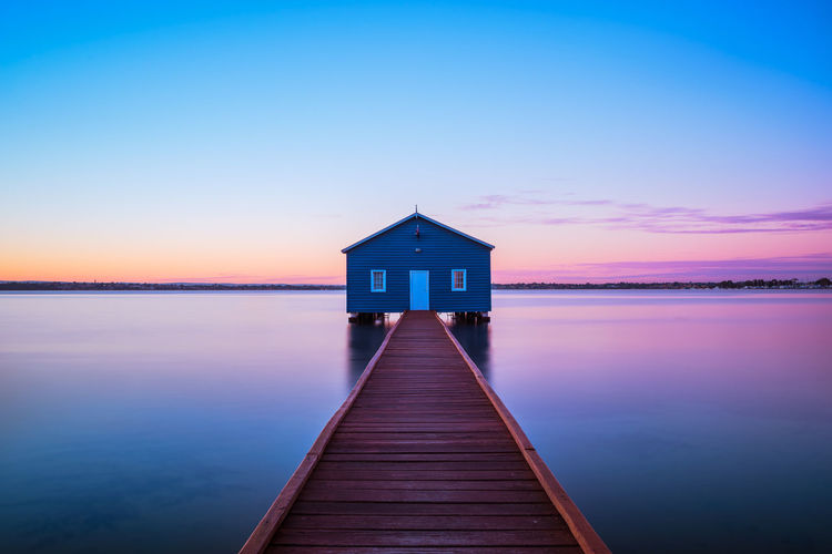 The infamous Blue Boat House Australia Flow  Travel Architecture Beauty In Nature Colorful Dawn Horizon Over Water House Idyllic Jetty Long Exposure Motion Nature No People Outdoors Pier Sea Sky Sunrise Tranquil Scene Tranquility Travel Destinations Water Wood - Material