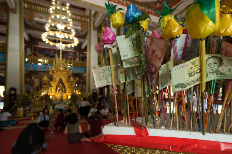 People donate to temples in Thailand Benefaction Beneficence Buddhism Buddhist Temple Close-up Day Decoration Donate Indoors  Money Thailand Monkey Philanthropy Place Of Worship Religion Spirituality Text Thailand Unrecognizable Person The Photojournalist - 2017 EyeEm Awards The Photojournalist - 2017 EyeEm Awards