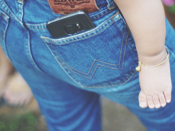 Mobile Conversations Jeans Blue Casual Clothing Pocket  Denim Midsection Human Body Part Lifestyles Denim Jacket One Person Close-up People Day Outdoors Baby Women Social Issues Togetherness EyeEmNewHere Friendship Eyeemphoto Blur Effect Bigass Travel Destinations