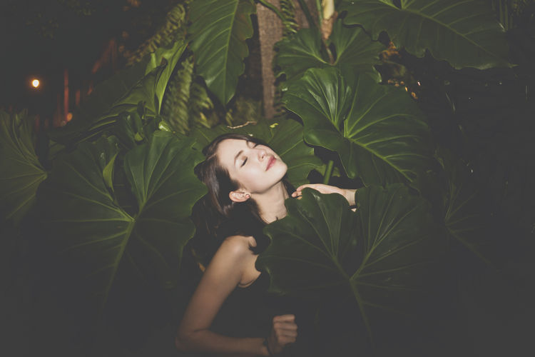 hidden in the jungle Big Leaf Bliss Casual Clothing Front View Green Color Growth Happiness In The Wild Leaf Leafs Leaves Nature Person Plant Wilderness Woman Woman Portrait Young Adult Young Women