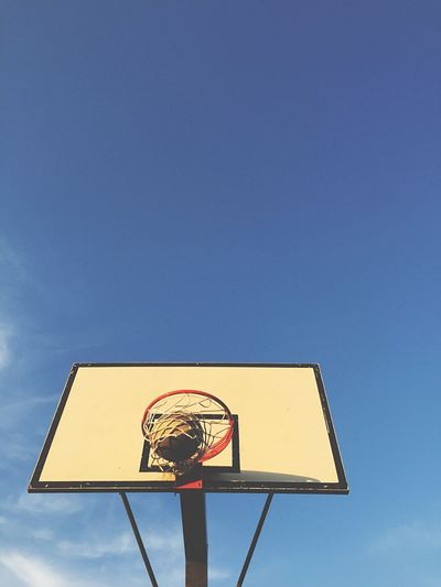 Playing basketball against sky Low Angle View Copy Space Basketball - Sport Blue Sport Basketball Hoop Sky Clear Sky Outdoors Day No People Competition Ball Sports Win Game Winner Basketball Basket Clear Sky Leisure Games Close-up Freedom Low Angle View