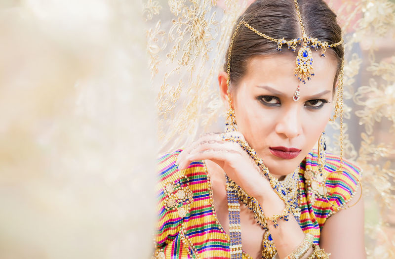 Close up Beautiful indian girl Young hindu woman model with kundan jewelry. One Person Women Real People Young Adult Portrait Lifestyles Young Women Front View Leisure Activity Make-up Beautiful Woman Headshot Adult Beauty Fashion Day Looking Outdoors Eyeshadow