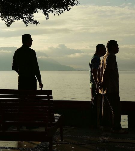 Enjoying the dawn... Silhouette People Men Outdoors LakeToba  Dawn Candidshot Candid Photography
