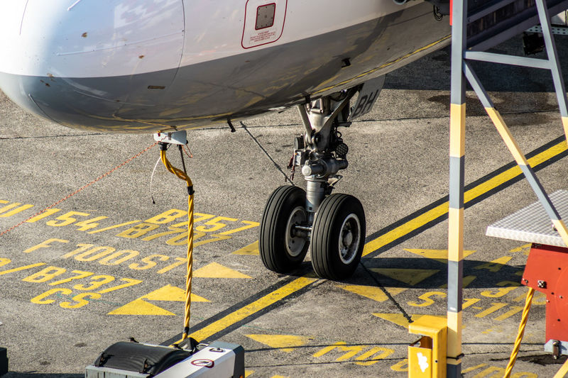 Apron Gate Public Transportation Service Traveling Aerospace Industry Air Vehicle Airplane Airport Airport Runway Day Ground High Angle View Land Vehicle Mode Of Transportation Outdoors Parking Public Transport Ramp Road Road Marking Sign Stationary Symbol Tire Transportation Travel Wheel Yellow