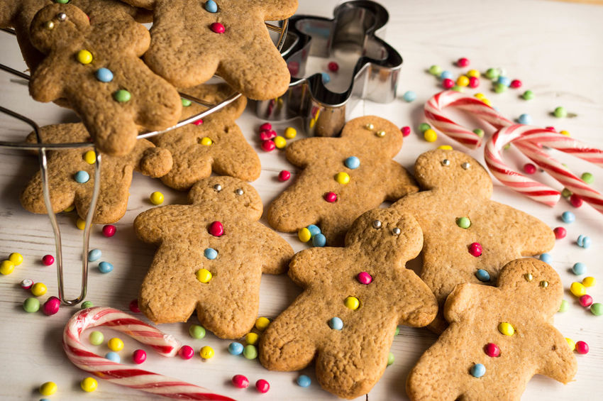 Gingerbread Men and Candy Baking Baking Cookies Biscuit Candy Christmas Decoration Close-up Cookies Food Gingerbread Man Gingerbread Men Multi Colored Sweet