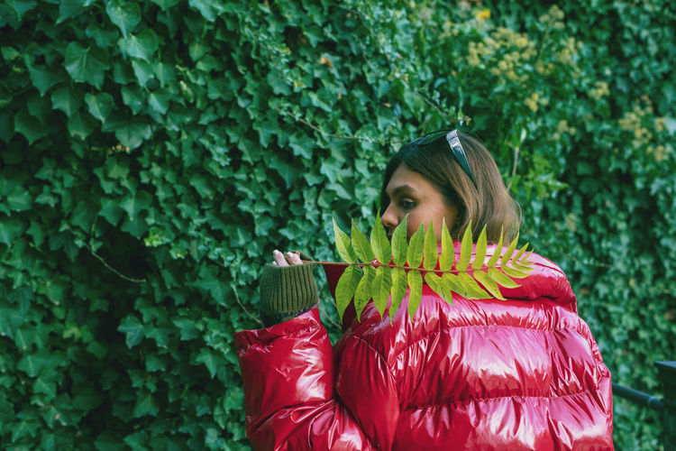 Woman standing by plants