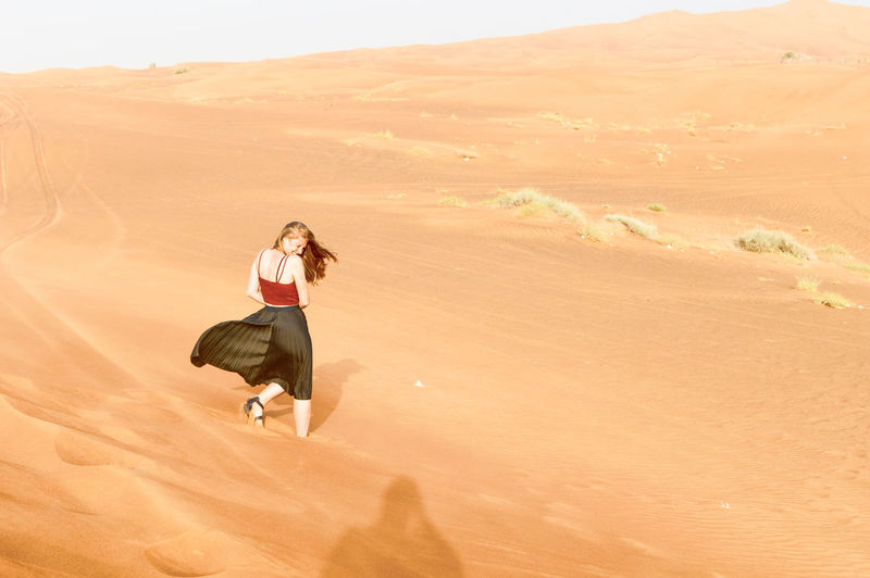 kingdom of sand Desert Dubai Arid Climate Beauty In Nature Climate Desert Desert Beauty Dry Environment Full Length Land Landscape Leisure Activity Lifestyles Nature One Person Outdoors Real People Sand Sand Dune Scenics - Nature Shadow Sunlight Tranquility Warm
