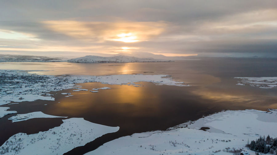 Iceland Iceland Wintertime Beauty In Nature Scenics - Nature Sky Water Cloud - Sky Tranquility Tranquil Scene Cold Temperature Winter Sunset Nature Reflection Snow No People Non-urban Scene Idyllic Mountain Lake Outdoors Snowcapped Mountain