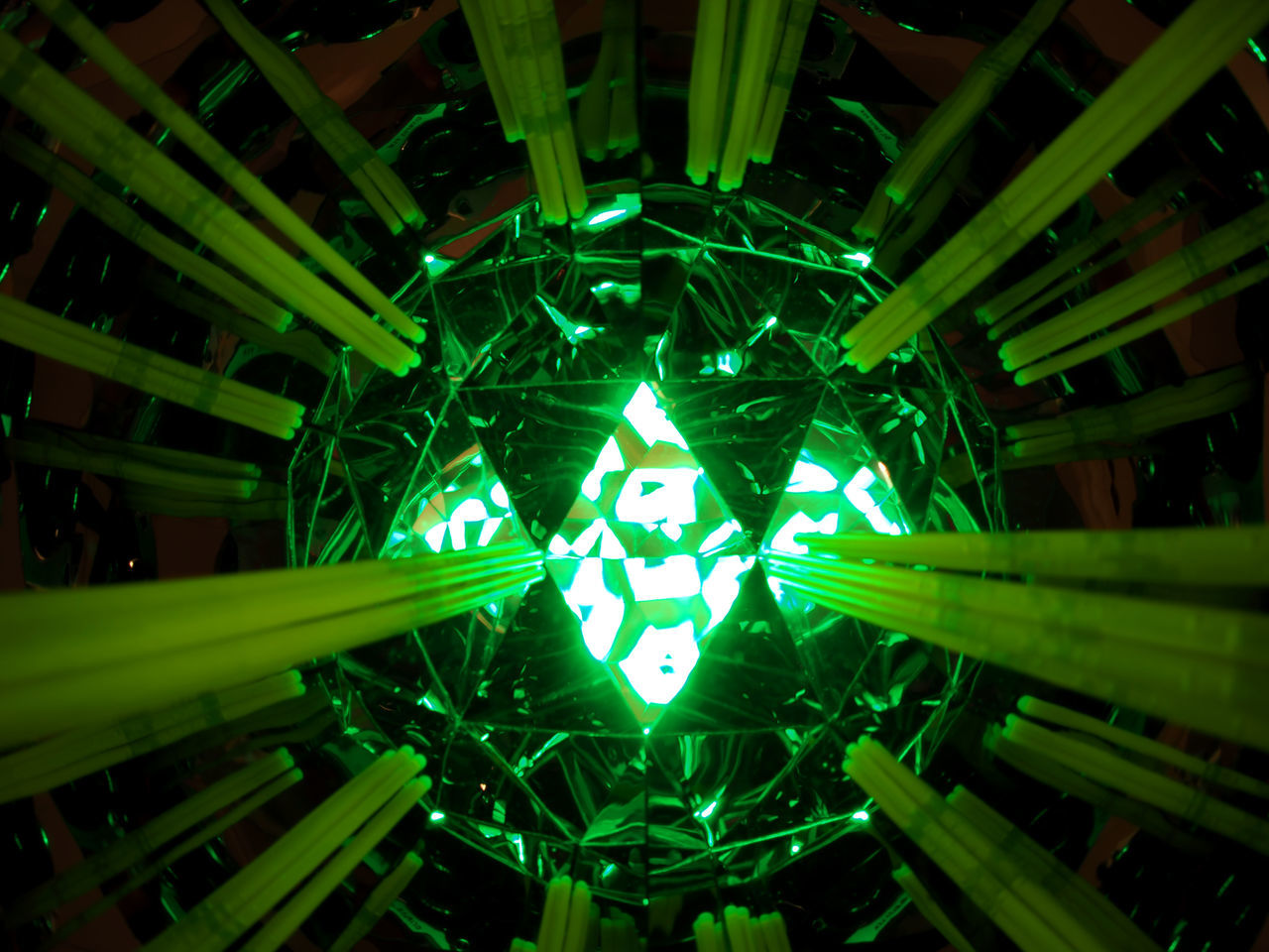 illuminated, green color, lighting equipment, no people, night, pattern, glowing, shape, indoors, close-up, light, light - natural phenomenon, electricity, decoration, low angle view, celebration, design, star shape, electric light, directly below, ceiling