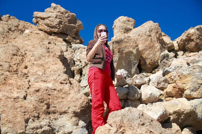 Adventure At The Edge Of The World Climbing Digital Girl Hiking Mobile Mountain Nature Outdoors Phone Photographer Rock Rock - Object Standing Taking Photo Taking Photos Taking Pictures Teide Tenerife Text Messages  Texting Trekking Volcano Young Women