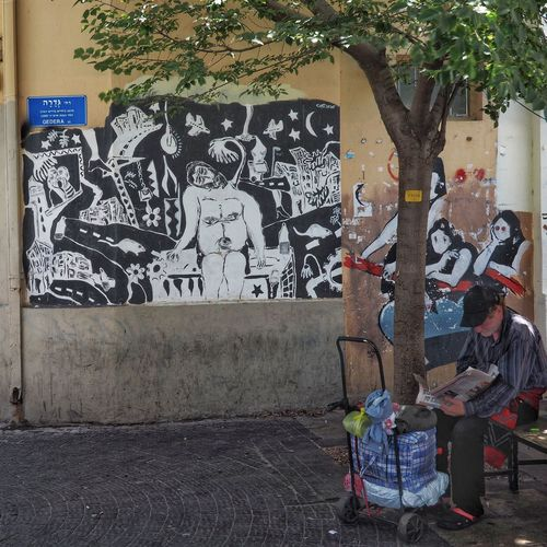 People by graffiti on wall