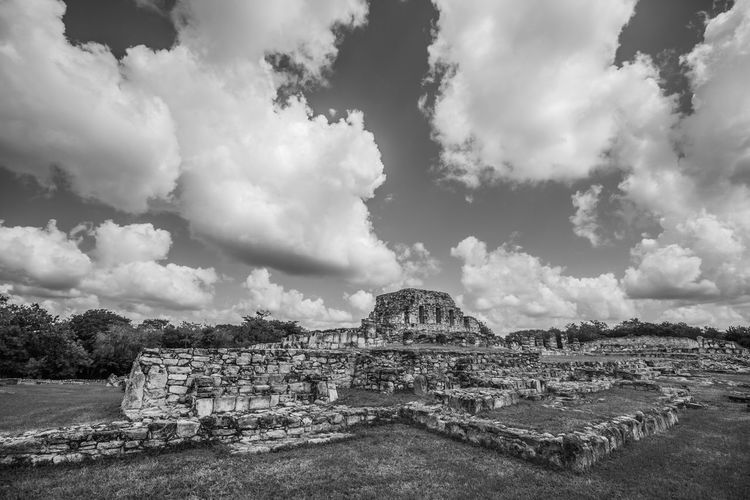 View of old ruins against cloudy sky