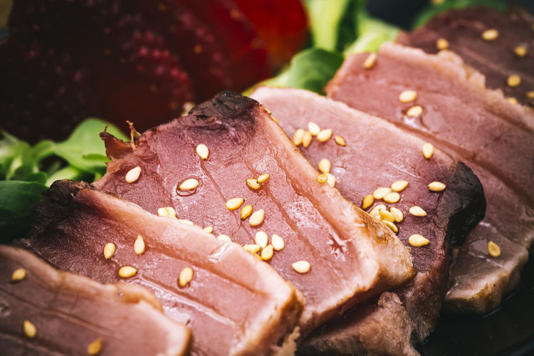 Close-up of tuna tataki garnished with sesame seeds