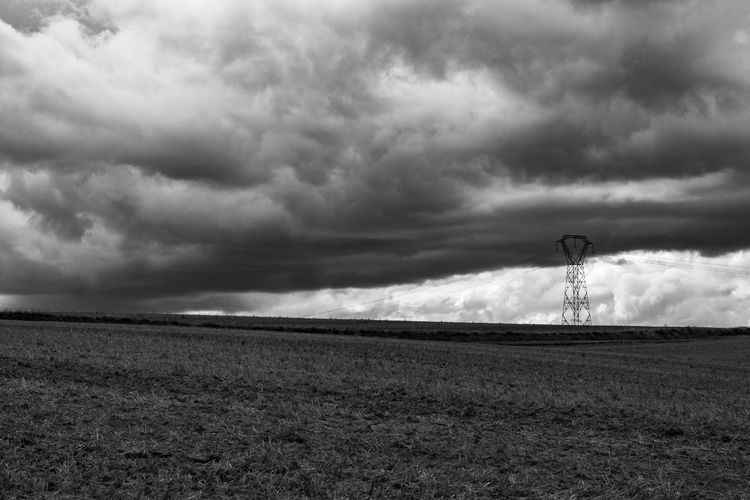 Untitled. Sentinel Series. Malephotographerofthemonth Pylon Beauty In The Mundane Moody Sky Atmospheric Mood Rural Scene Agriculture Storm Cloud Field Sky Cloud - Sky Landscape Thunderstorm Storm Overcast Dramatic Sky Plowed Field Agricultural Field