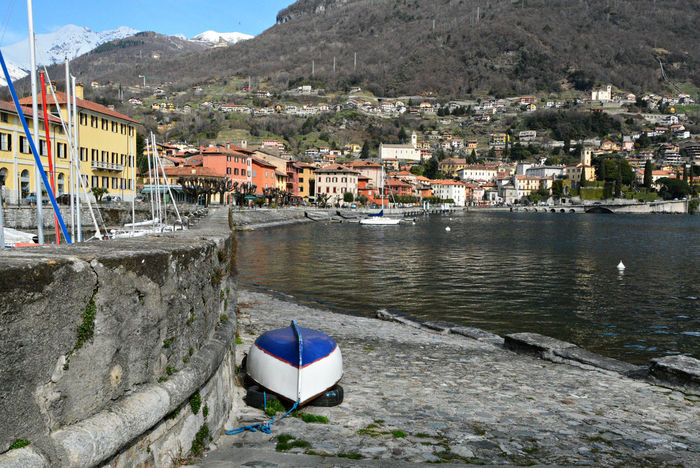 Upturned boat at the harbor - Gravedona, Como, Lombardy, Italy. City Cityscape Gravedona Harbor Harbour Italia Lario Lombardy Travel Beauty In Nature Boat Europe Italy Lake Como Lombardia Moored Mountain Nature Outdoors Tourism Town Urban Water