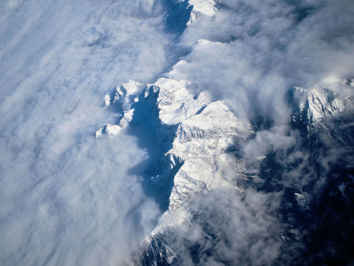 Aerial View Of Clouds Covered Snowcapped Mountains