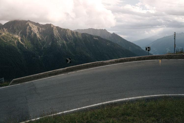 Serpentine mountain road with mountain range