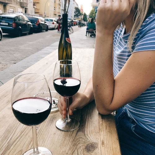 Wineglass Red Wine Wine Food And Drink Alcohol Drink Real People Table Refreshment One Person Lifestyles Drinking Drinking Glass Day Women Outdoors Food Close-up Winetasting Freshness Connected By Travel