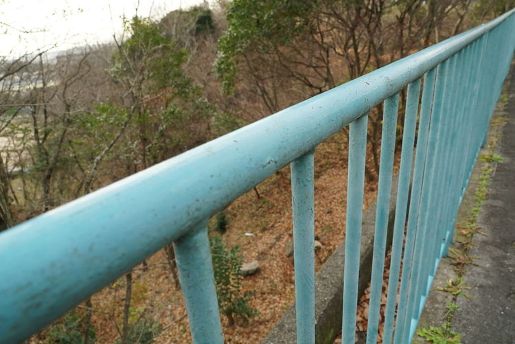 High angle view of railing by fence