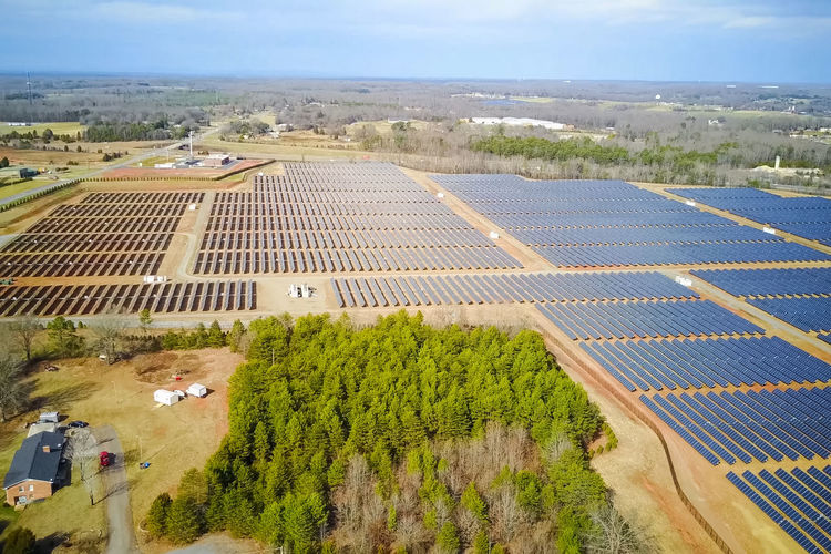 solar panels Landscape Environment High Angle View Plant Day Tree Nature Growth Sky Scenics - Nature Transportation Rural Scene Agriculture Beauty In Nature Field Land Cloud - Sky No People Green Color Architecture Outdoors Solar Panels