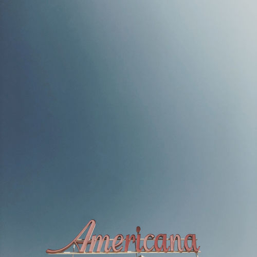Low angle view of sign against clear sky