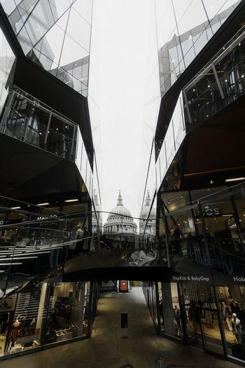 Modern bridge in city against sky