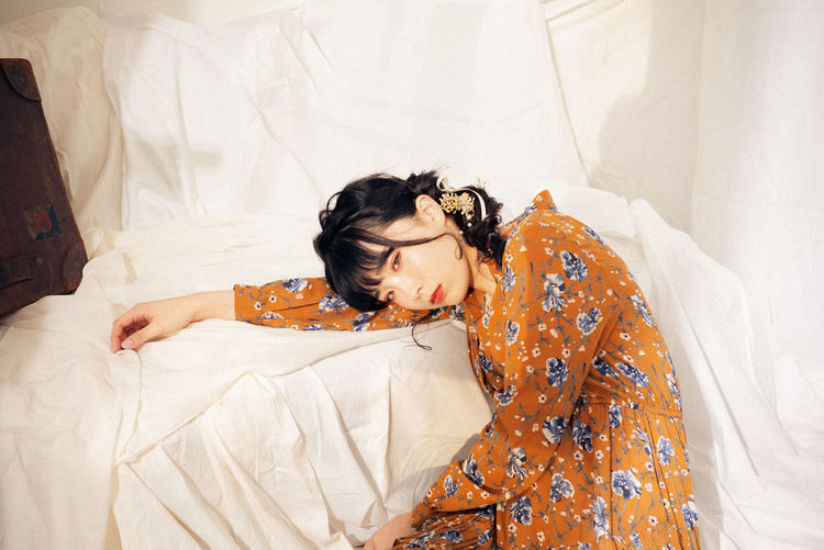 Young woman lying on bed at home
