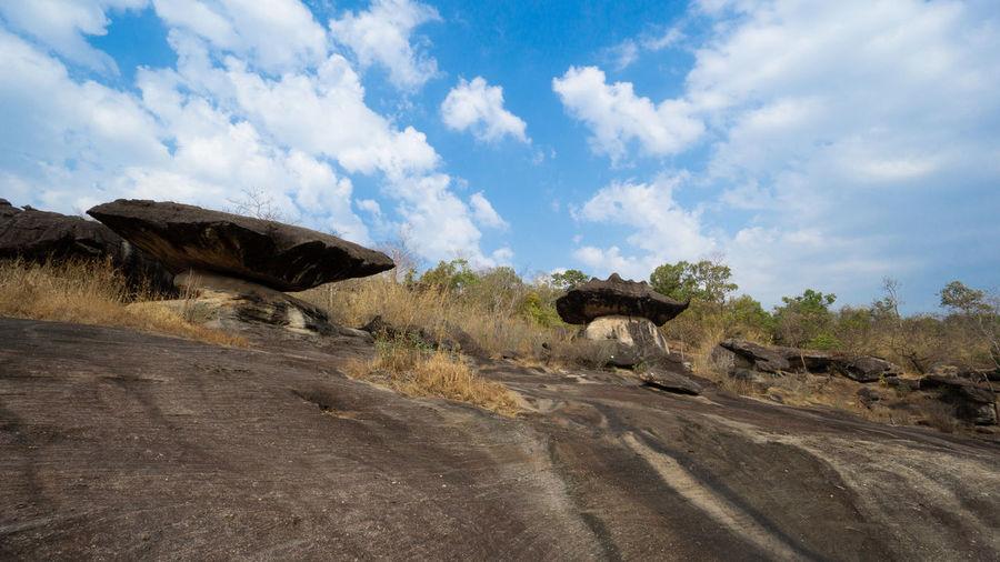 Panoramic shot of rocks on road against sky