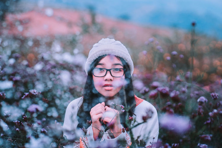 Snow Sometimes Falls. enjoying beautiful winter day and snow. Young woman in the garden that snow is falling. Happiness Christmas Snowing Snowcapped Mountain Snow Vintage Celebration Outdoors Beautiful Woman Warm Clothing Glasses Adult Looking At Camera Eyeglasses  Winter Clothing Nature Leisure Activity Plant Lifestyles Young Adult Headshot One Person Front View Portrait