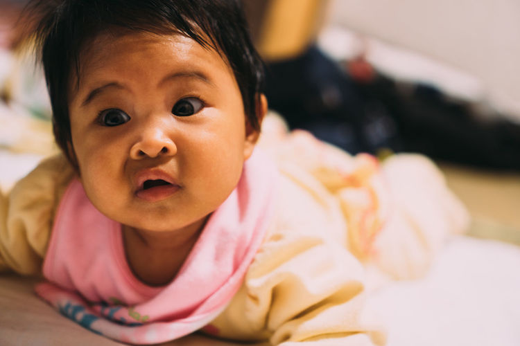 Portrait of cute baby girl at home