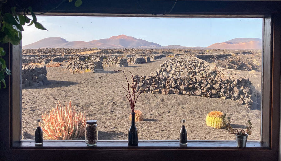 Panoramic view of landscape and mountains seen through window