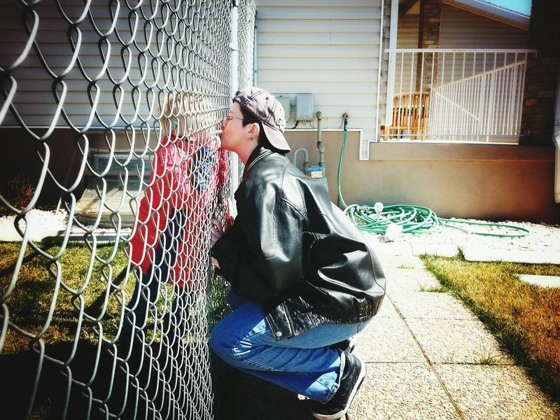 Fence kisses. Lgbt Family Family Queer Women Lgbt Mom Love Everyday Joy Son Togetherness Smartphone Photography Real Life Kiss Real People Woman Lesbian Boy Fence Yard Family Matters Lifestyles People