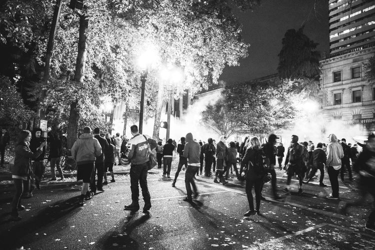 Taken at an Anti-Trump protest, which turned into a riot. In the photo you can see Tear Gas || Antitrump Peacefulprotest Portland Social Documentary