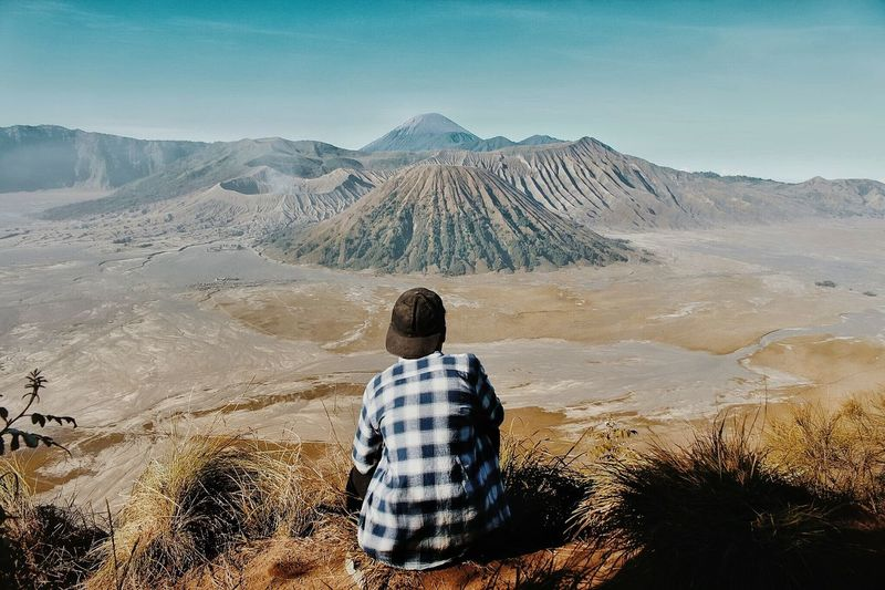 Bromo Rear View Mountain Hiking Landscape Remote Adventure Scenics One Person Adult Nature Tranquility Beauty In Nature Adults Only Men Only Men Mountain Range Nature Outdoors Travel Destinations People Day Sky Fresh On Market 2017