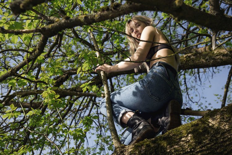 Hiding Game Branches Up In A Tree Blue Jeans Bralette Blonde Girl Model Spring Blue Sky Green Leaves Nature Exploring Beauty In Nature Linas Was Here