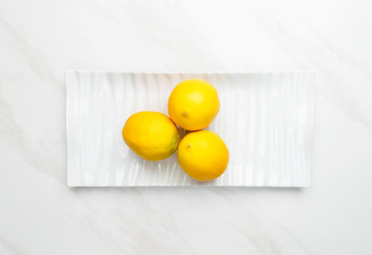 High angle view of yellow fruits on table
