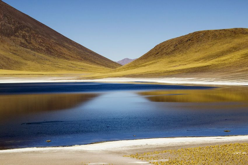 Mountain Tranquil Scene Water Scenics Tranquility Clear Sky Lake Idyllic Non-urban Scene Remote Travel Destinations Nature Beauty In Nature Mountain Range Outdoors Tourism Sky Majestic No People Vacations Chile San Pedro De Atacama Lagoon Miñiques Lagoon