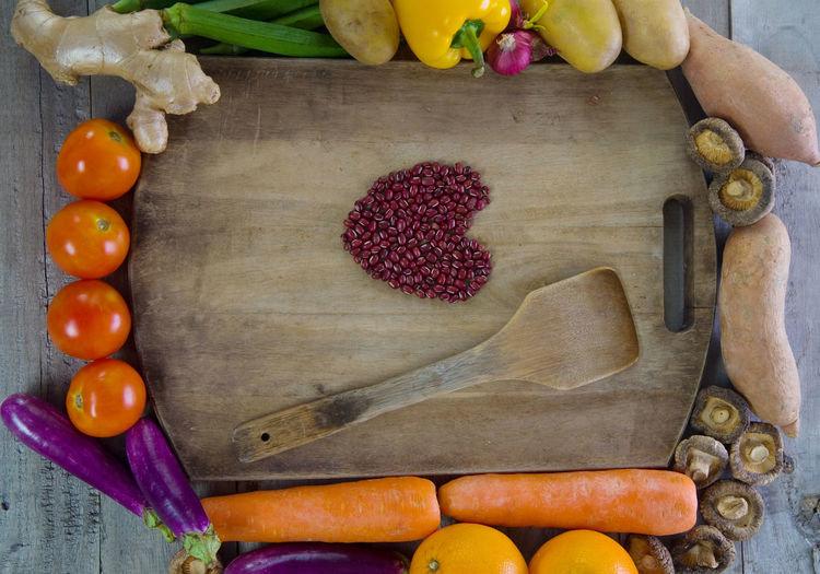 Fruits and vegetables by cutting board with beans
