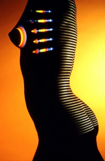 Close-up of silhouette man against illuminated light