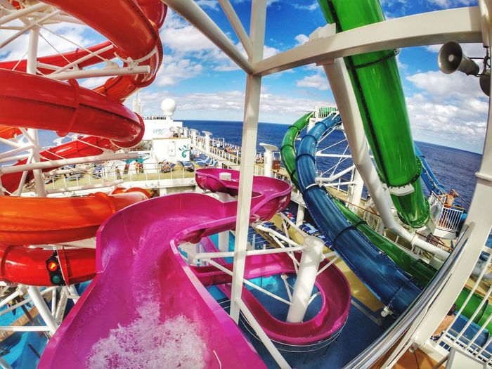 Colorful water slides on cruise ship in sea