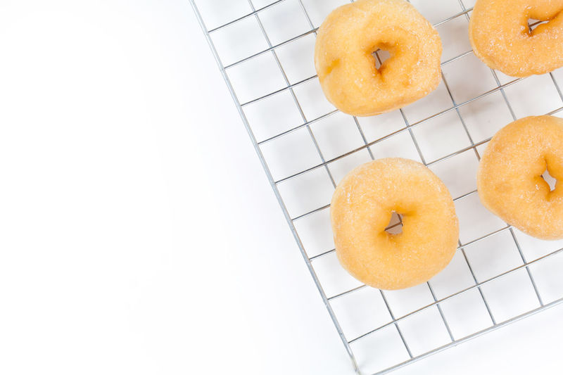 Background Baked Bakery Bitten Breakfast Brown Bun Cake Calories Circle Closeup Delicious Dessert Donut Donuts Dough Eat Fat Food Fresh Fried Frosting Glazed Gold Grille Icing Isolated Junk Pastry Round Snack Sugar Sugary Sweet Tasty Top Treat Unhealthy View White Yellow Yummy