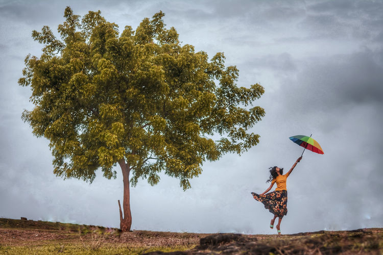 Freedom is choice Girl Flying Umbrella Warm Yellow Freedom Tree Rural Scene Full Length Adventure Sky Cloud - Sky