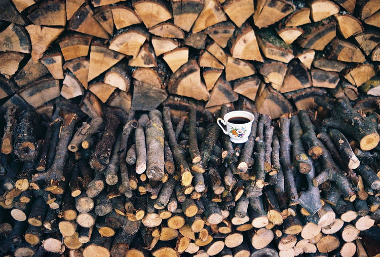 Full Frame Shot Of Firewood With Coffee Cup